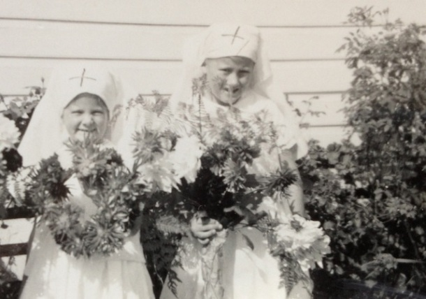 Ready for the Anzac Day March - my 2 little Red Cross girls Anne and Lyndell holding their home made wreaths