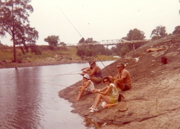 Beryl and Lloyd Bowden and others at Max Gorton's, with the old Washpool Bridge in the background