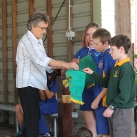 Presenting 3 school with Stroud Lions club banner (email)