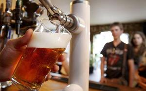 A pint of beer is pulled in a pub in London, Monday, July 28, 2008. The iconic British pint is fast losing ground as the national drink, with a report out Monday showing beer sales in pubs slumping to their lowest level since the Great Depression. (AP Photo/Kirsty Wigglesworth)